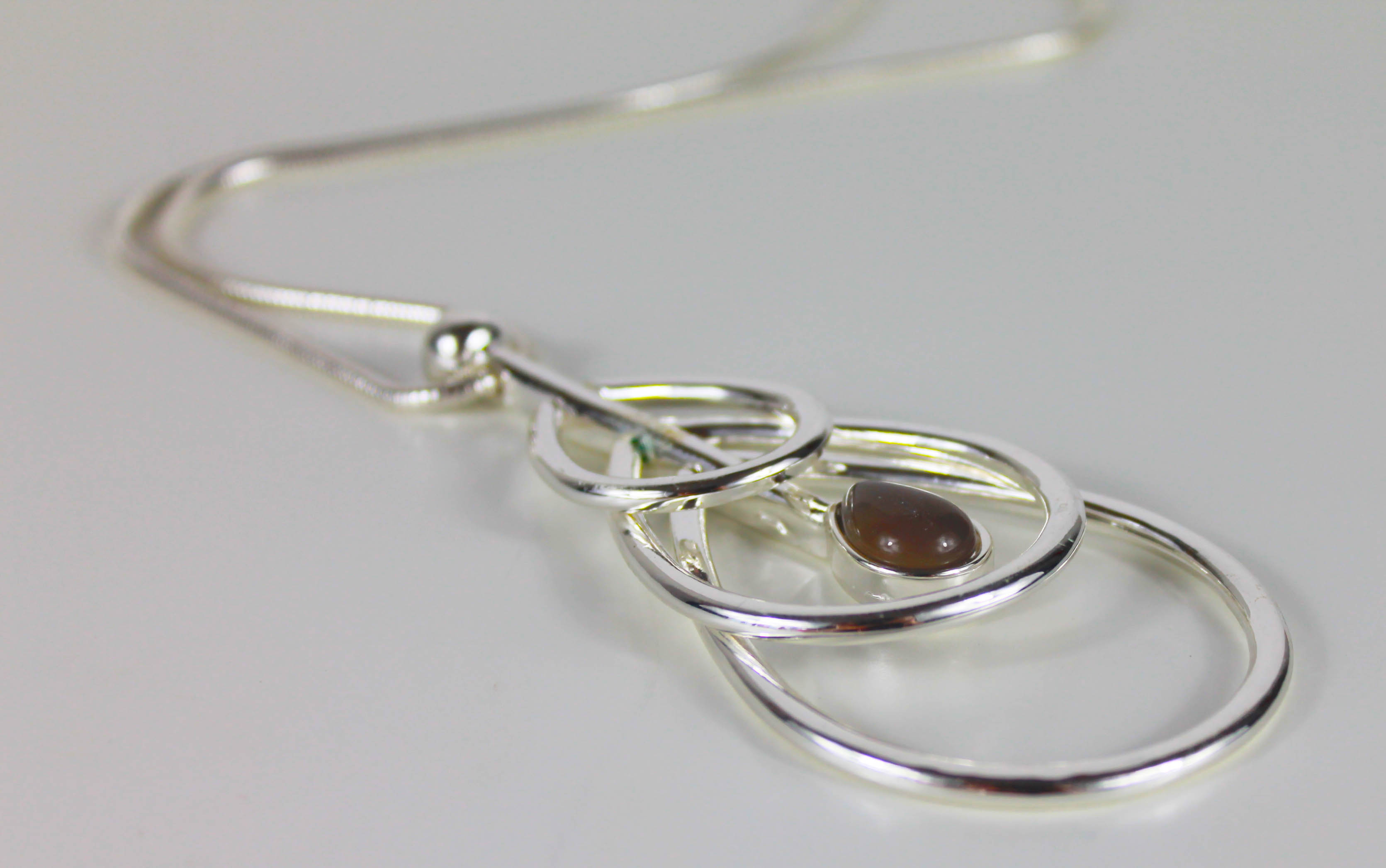 Silver Famile triple ring with opal drop necklace