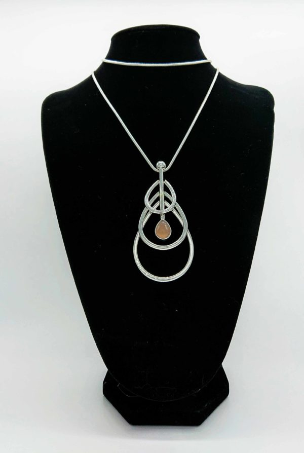 Famile Necklace Longer length silver box chain necklace with a three tiered pendant. A drop pendant with a single dark opal stone effect feature. This beautiful long necklace is a statement piece that can be worn when casual as well as more formal wear Nickel free, silver coloured mixed metal